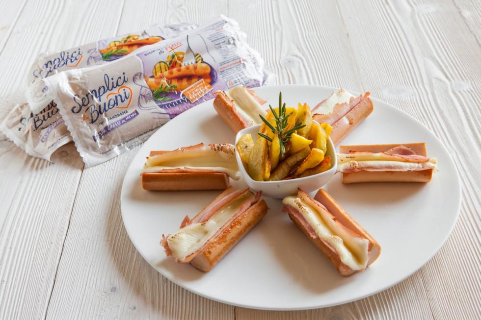 Ricetta wurstel di pollo gratinati con formaggio e prosciutto cotto ...