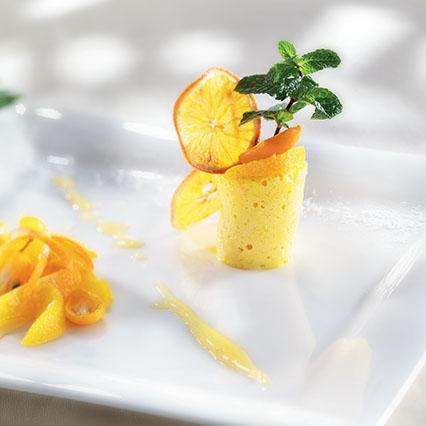 Budino di ricotta con salsa di arance