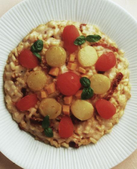 Riso con zucca, pomodorini e topinambour