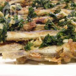 Pesce fritto con prezzemolo e aglio