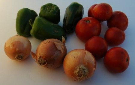 Ricetta tacchino tricolore con peperoni, pomodori e cipolle