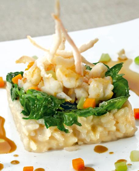 Risotto con spinaci, ragú e salsa di scampi