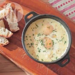 Uova al forno con prosciutto cotto