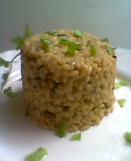 Torretta di riso ai funghi, pinoli, ruchetta selvatica e burrata (puglia)
