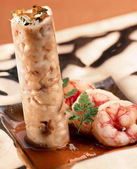 Risotto con porcini secchi, aglio, prezzemolo e gamberoni